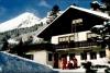 Das Chalet Hermann im Winter direkt an der Skipiste
